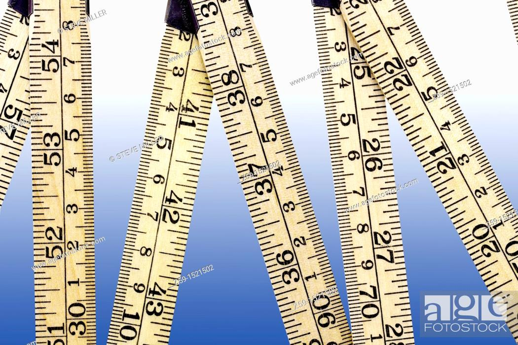 Stock Photo: digital enhancement - ruler with metric and inch system.