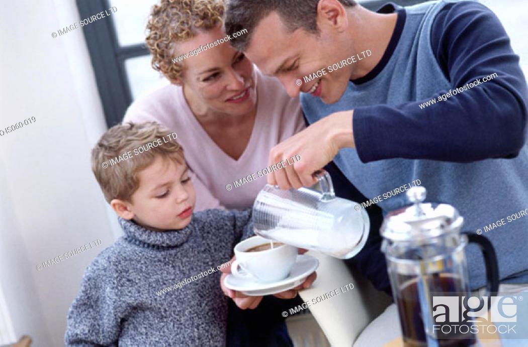 Stock Photo: Family at breakfast.