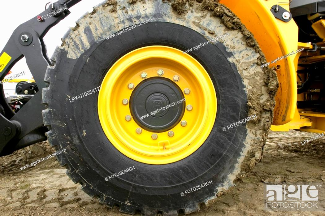 Stock Photo: Muddy tyre on a digger.