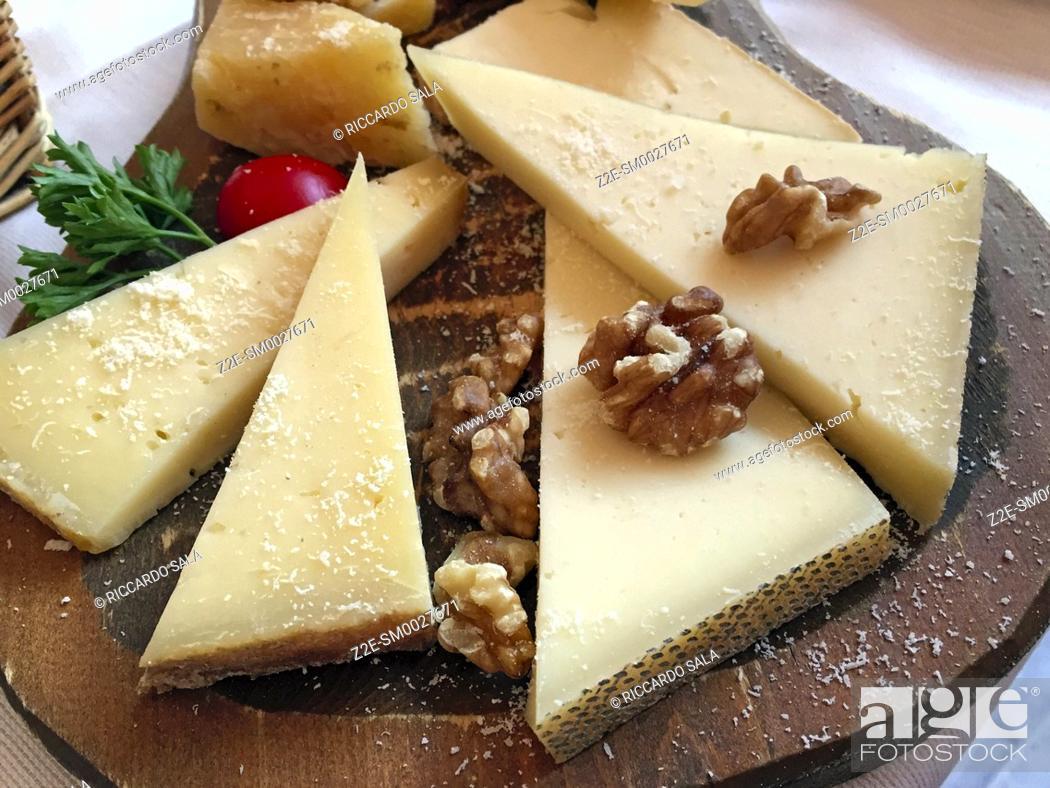 Stock Photo: Italy, Lombardy, Tirano, Cheese Platter with Walnuts.
