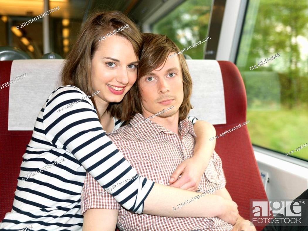 Stock Photo: Couple embracing on train.