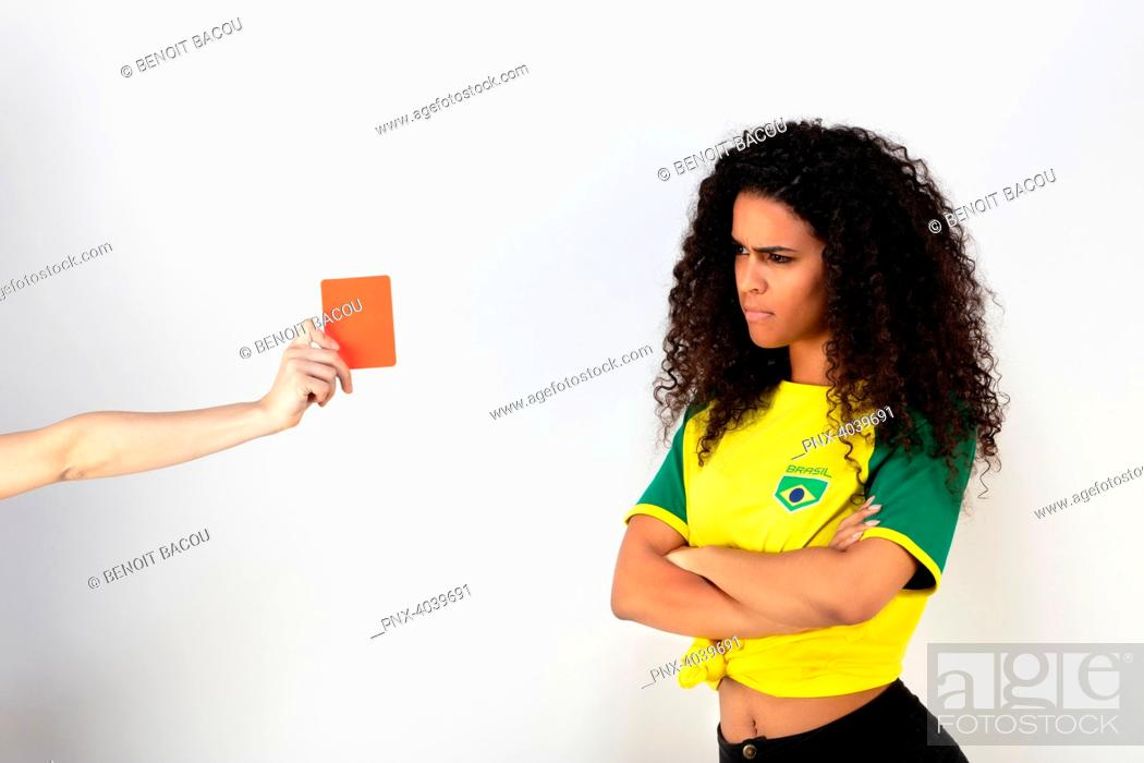 Stock Photo: Portrait of a young supporter of the Brazil team taking a red card.