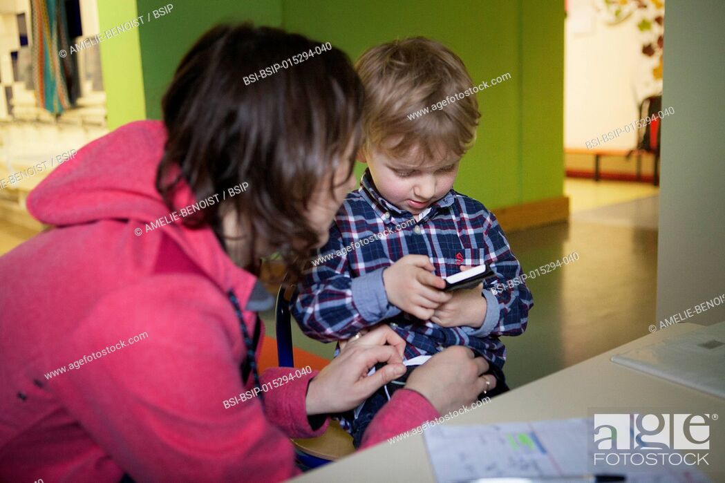 Stock Photo: Reportage on the daily life of Oscar, a 3 and a half-year old boy who has type 1 diabetes. Oscar has a glucose sensor and insulin pump.