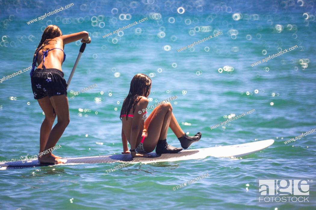 Stock Photo: Girls on surfboard paddling in the Mediterranean Sea, Benicassim, Castellon province, Comunidad Valenciana, Spain.