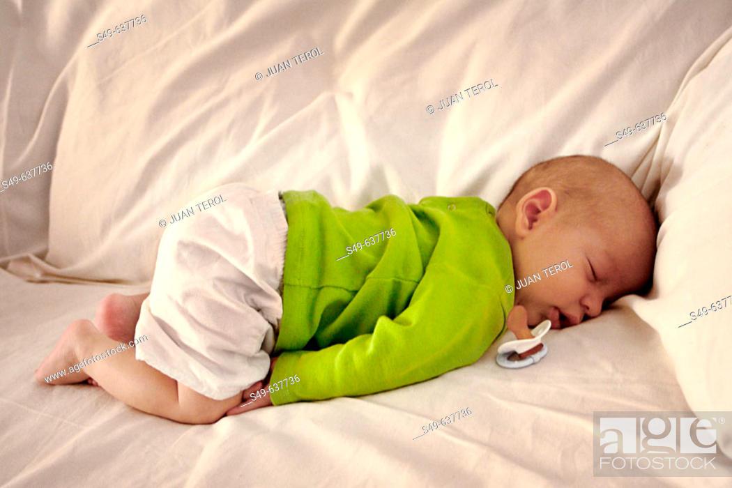 Stock Photo: Baby napping on sofa.