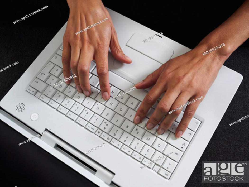 Stock Photo: Woman typing on laptop computer.