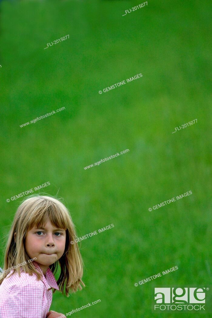 Stock Photo: Girl With Green Grass Background.