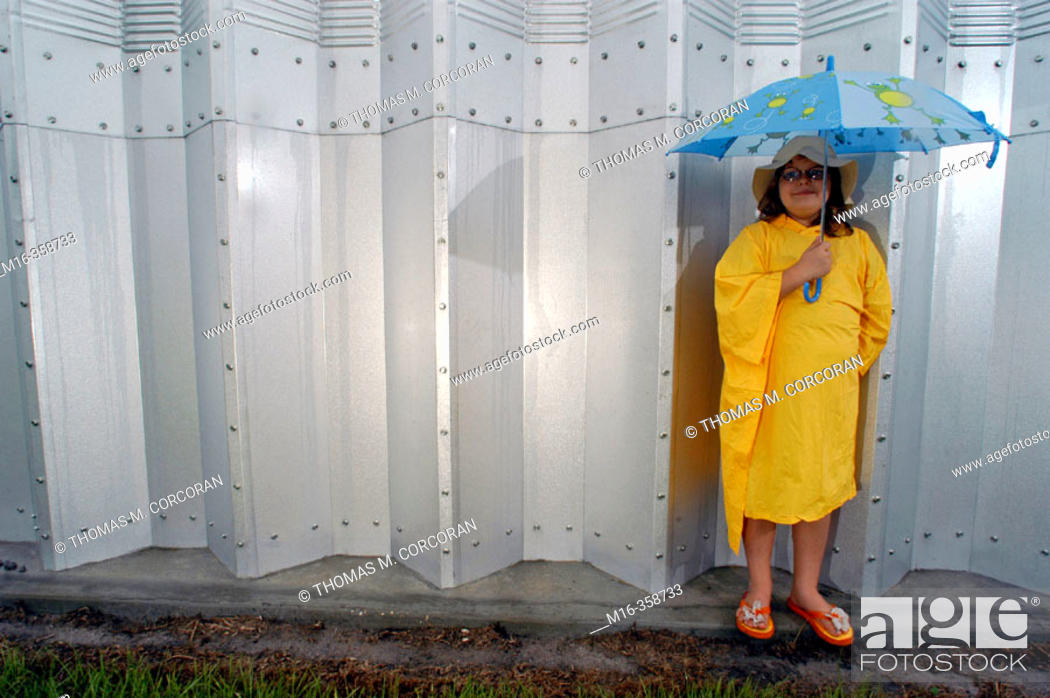 Stock Photo: A little girl waits for the frequent rains of Central Florida. Summerfield. USA.