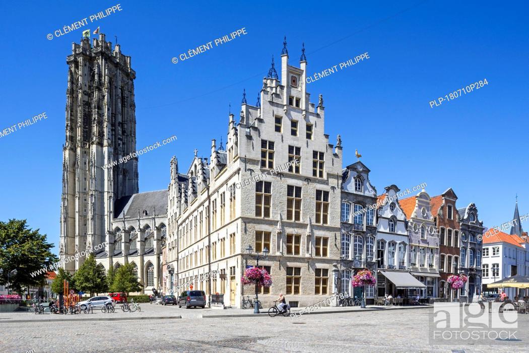 Stock Photo: De Beyaert, former city hall now Post Office and St. Rumbold's Cathedral / Sint-Romboutskathedraal in the city Mechelen / Malines, Flanders, Belgium.