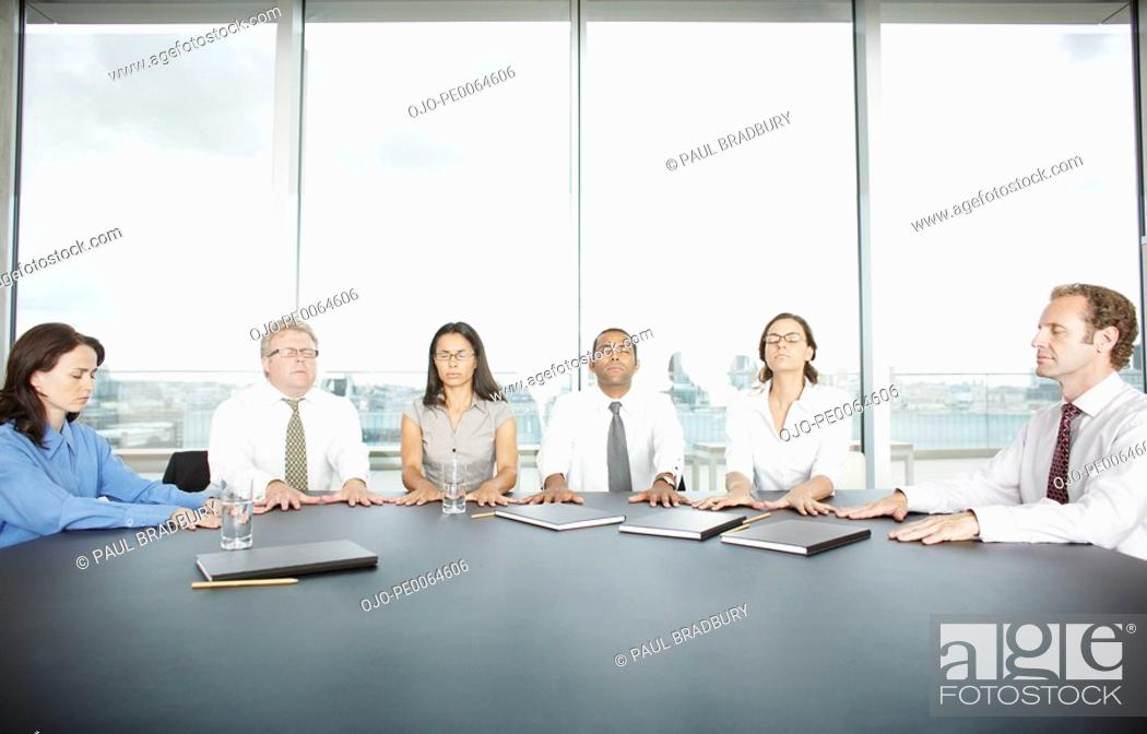 Stock Photo: Businesspeople having seance at conference table.