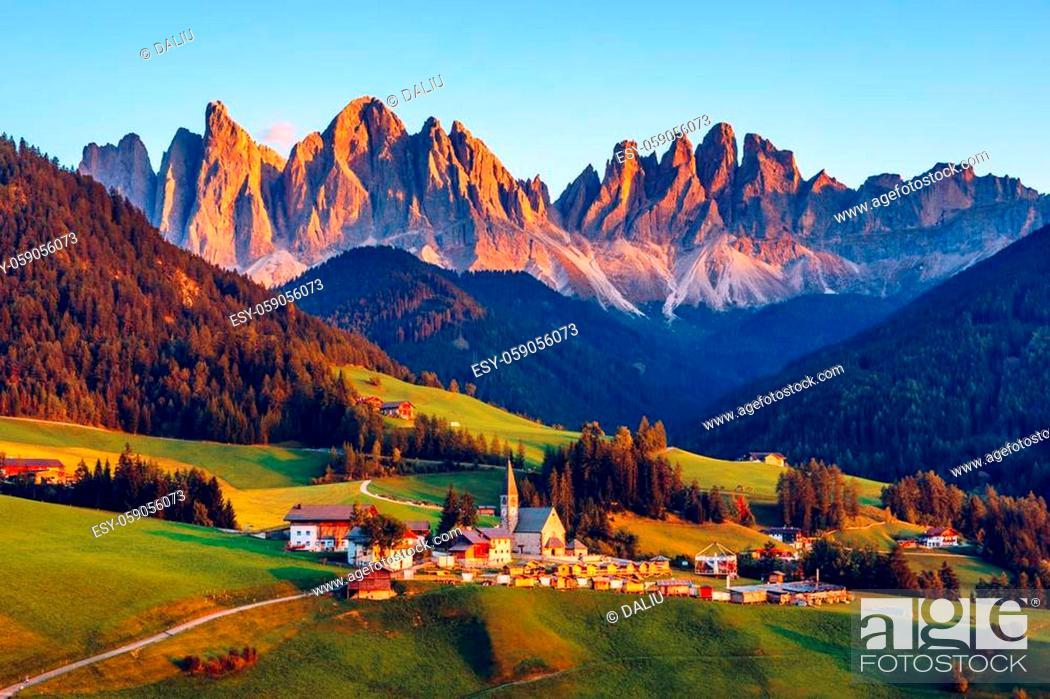 Stock Photo: Santa Maddalena (Santa Magdalena) village with magical Dolomites mountains in autumn, Val di Funes valley, Trentino Alto Adige region, South Tyrol, Italy.