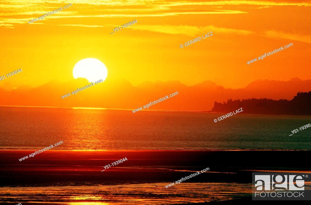 Stock Photo: Sunset on Ocean in Alaska.