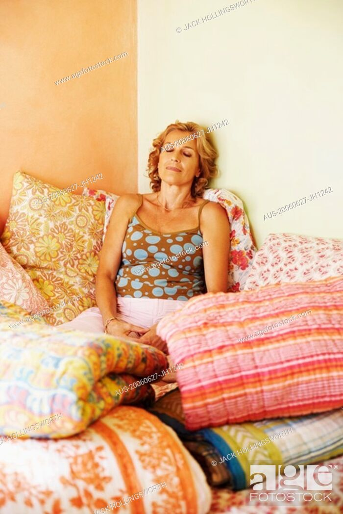 Stock Photo: Mature woman resting on the bed.