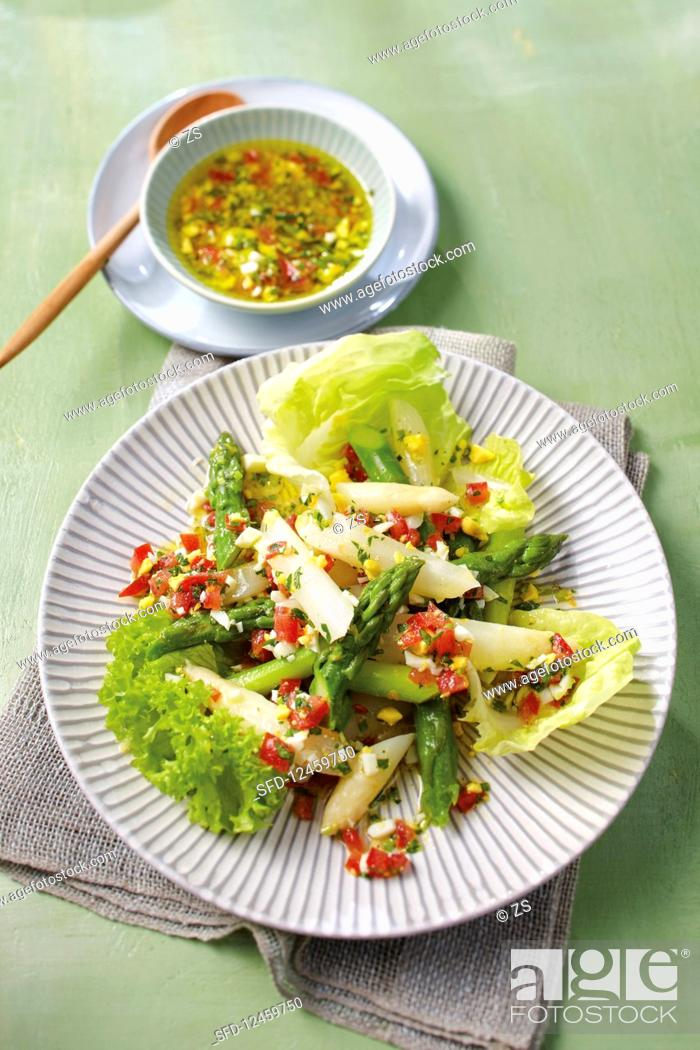 Stock Photo: Green and white asparagus salad with tomato and egg vinaigrette.