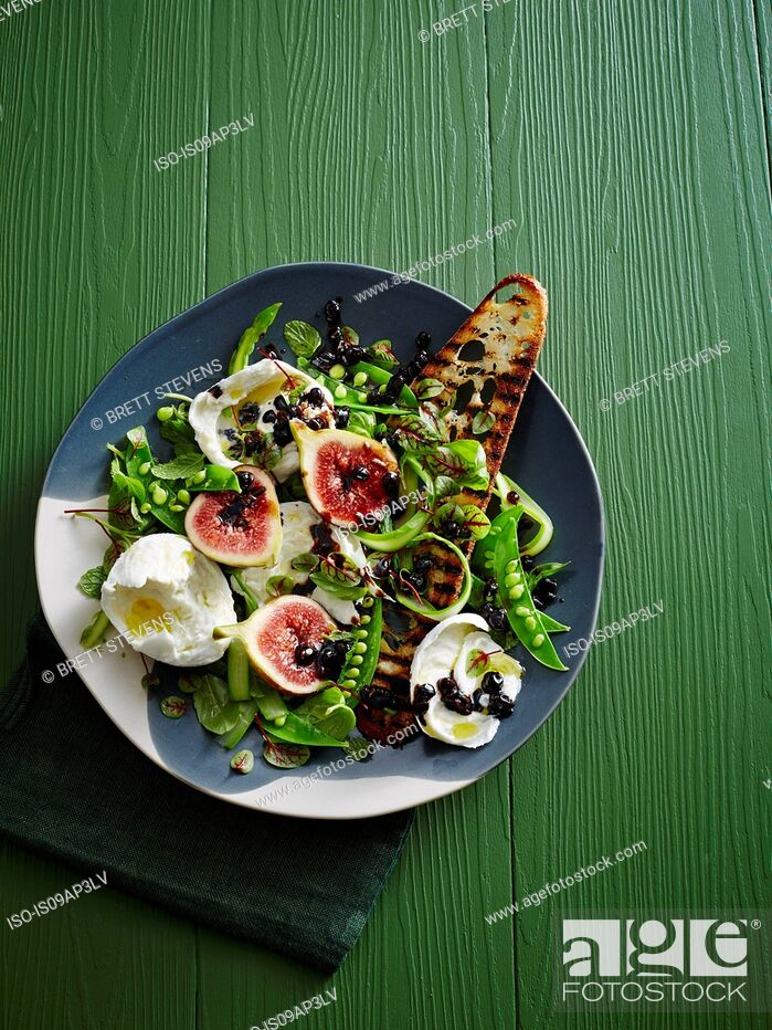 Stock Photo: Plate of pea Salad - figs, balsamic glaze, burrata, micro herbs, asparagus and grilled sourdough bread.