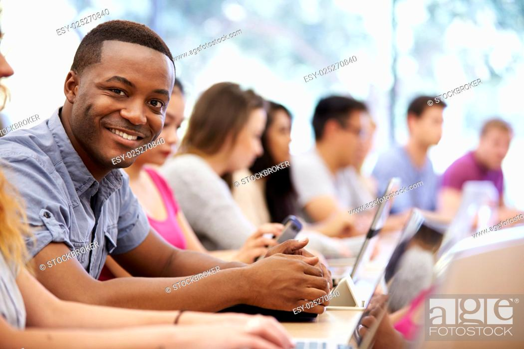 Stock Photo: Class Of University Students Using Laptops In Lecture.