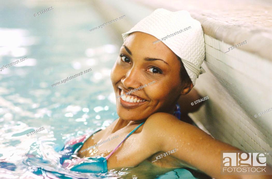 Stock Photo: African american woman wearing bathing cap in indoor swiming pool.