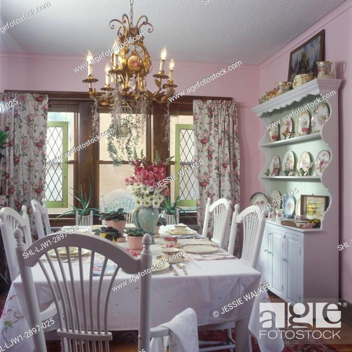 Stock Photo Dining Rooms Vintage Curtians Shabby Chic Cottage Look Light Pink Walls White Chairs And Tablecloth Chandelier Salvaged Tudor Style