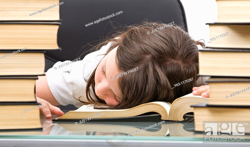 Stock Photo: Shot of a Young School Child Asleep at her Desk.