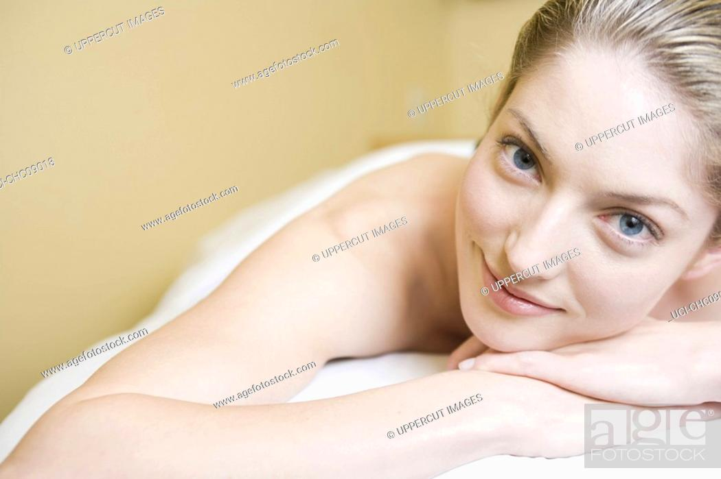 Stock Photo: Woman laying on spa table.