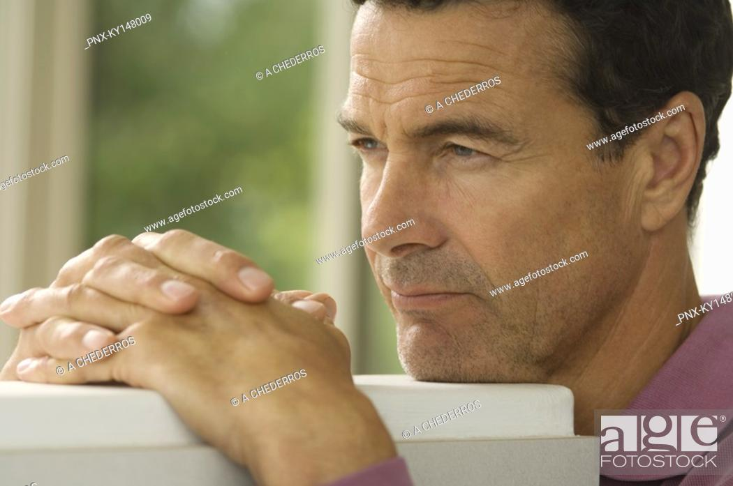 Stock Photo: Portrait of thinking man.