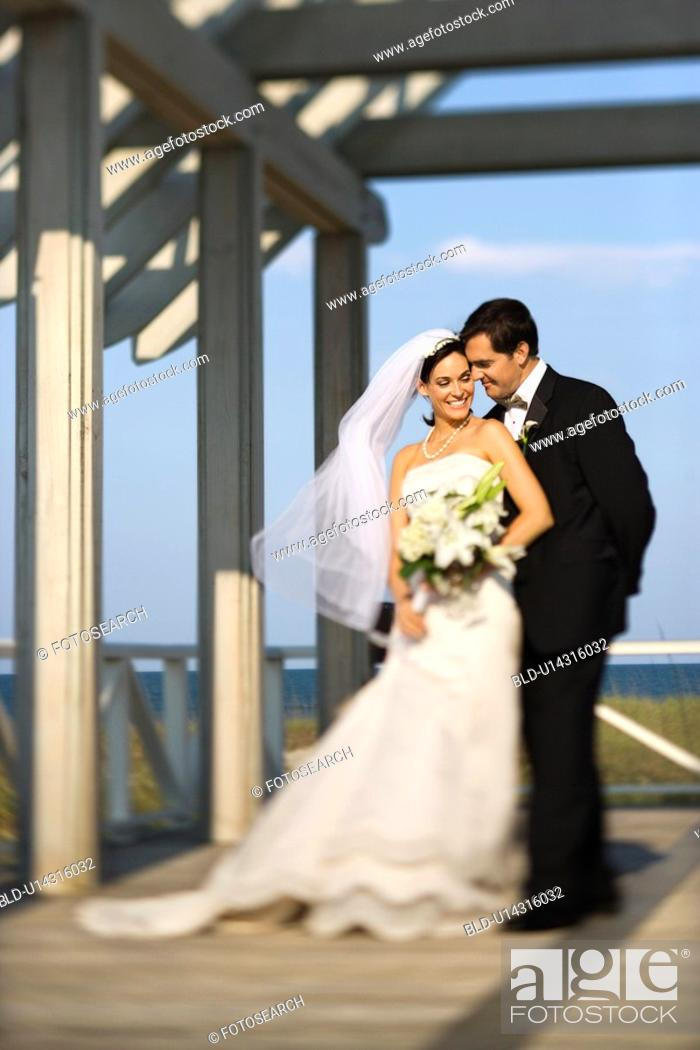Stock Photo: Bride and groom standing together.