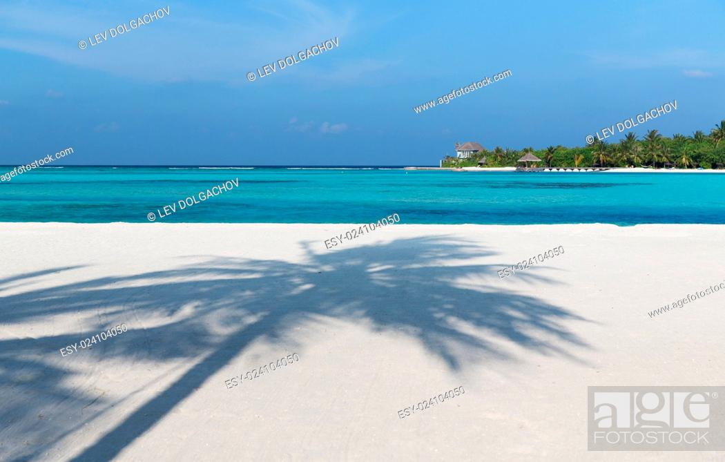 Stock Photo: travel, tourism, vacation and summer holidays concept - maldives island beach with palm tree and villa.