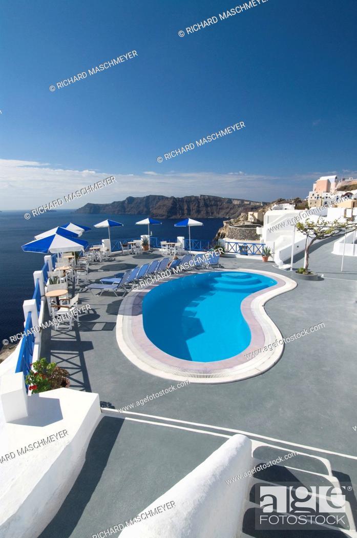 Stock Photo: Hotel swimming pool, Oia, Santorini, Greece.