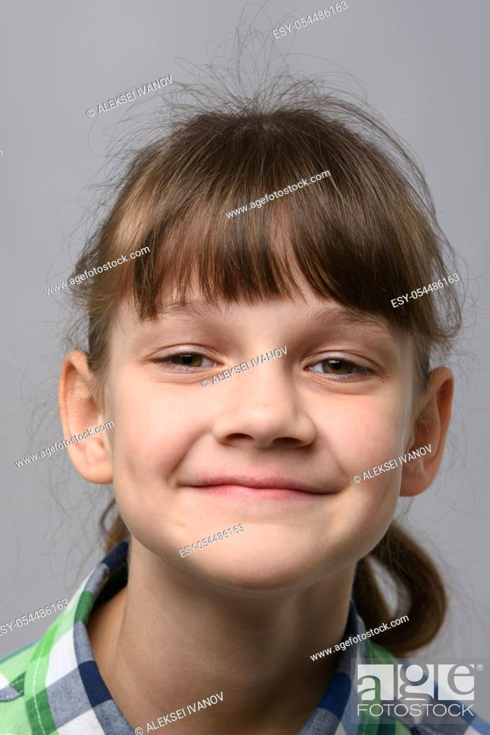 Stock Photo: Portrait of a happy ten-year-old girl of European appearance, close-up.