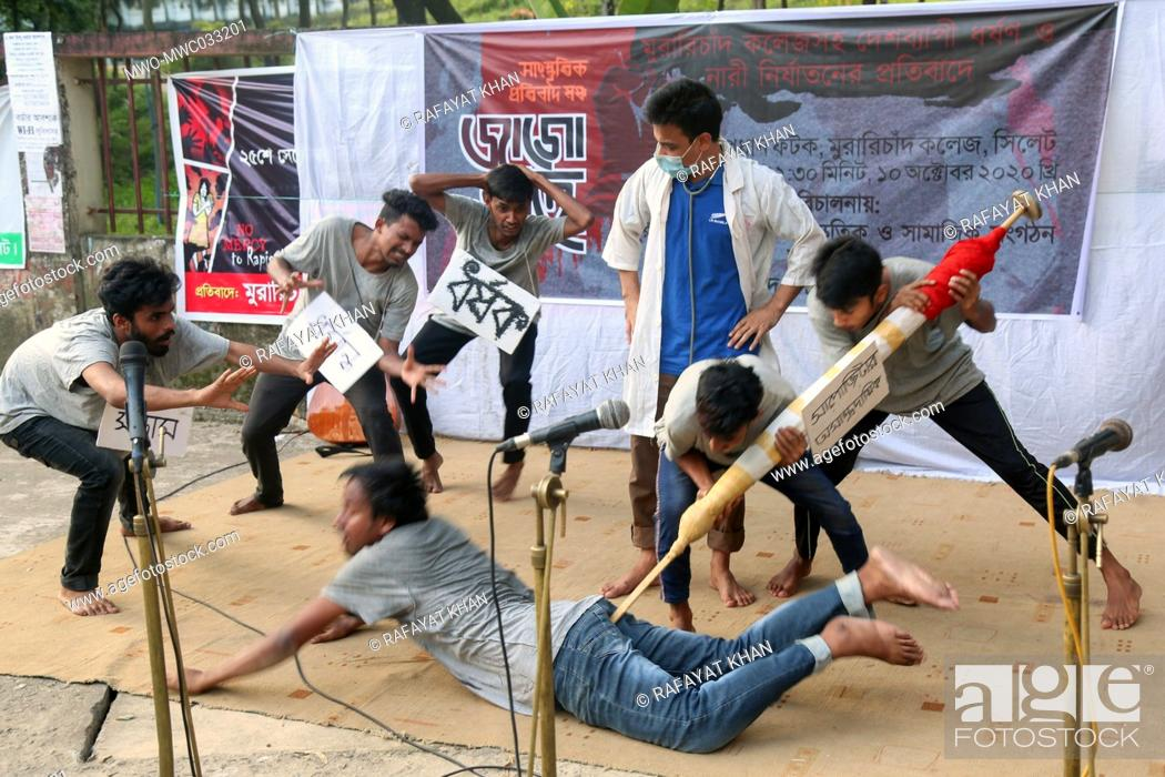 Stock Photo: MC College theatre, Sylhet staged a drama as a demonstration for the ongoing mass rape, lawlessness, injustice and atrocities in Bangladesh and demanded maximum.