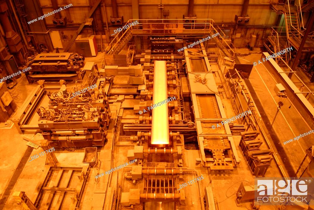 Stock Photo: SSAB Swedish Steel Ab, Lulea, Sweden: the 1,600 degree Celsius molten metal solidifies into 25 ton and 11 meter long slabs of steel.