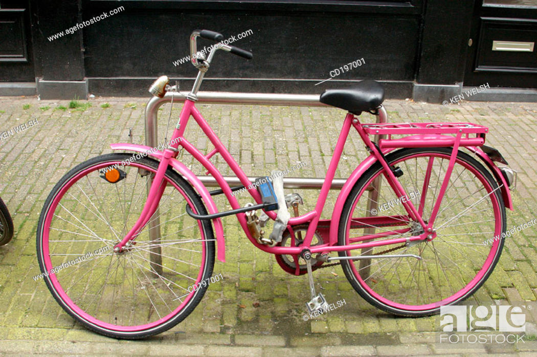 Stock Photo: Pink bike in street. Amsterdam. Holland.