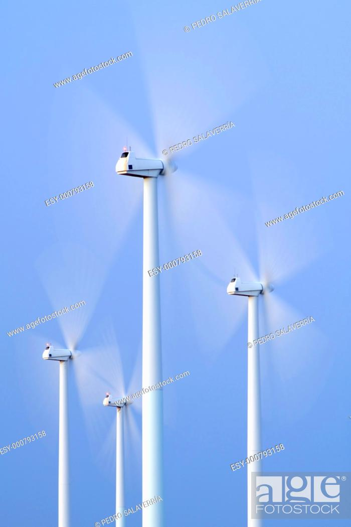 Stock Photo: blades of a group of modern windmills turning in La Muela, Saragossa, Aragon, Spain.