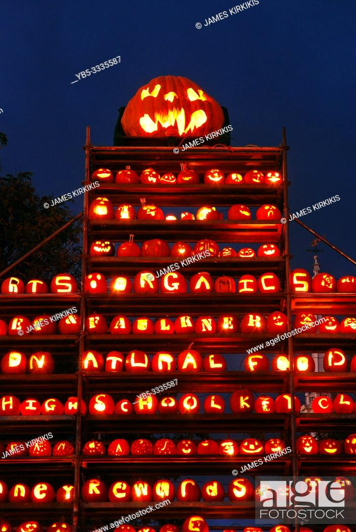 Stock Photo: Hundreds of carved pumpkins tower into the sky at a pumpkin festival in Keene New Hampshire.
