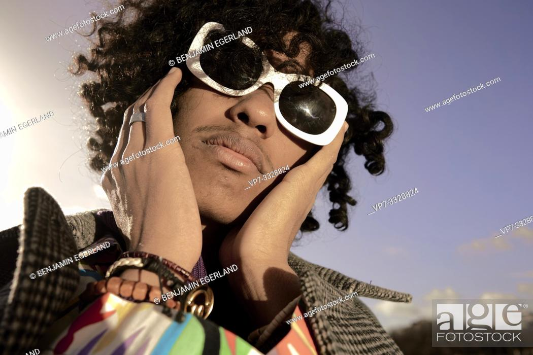 Stock Photo: young emotive fashion model man wearing fancy designer sunglasses, in Paris, France.