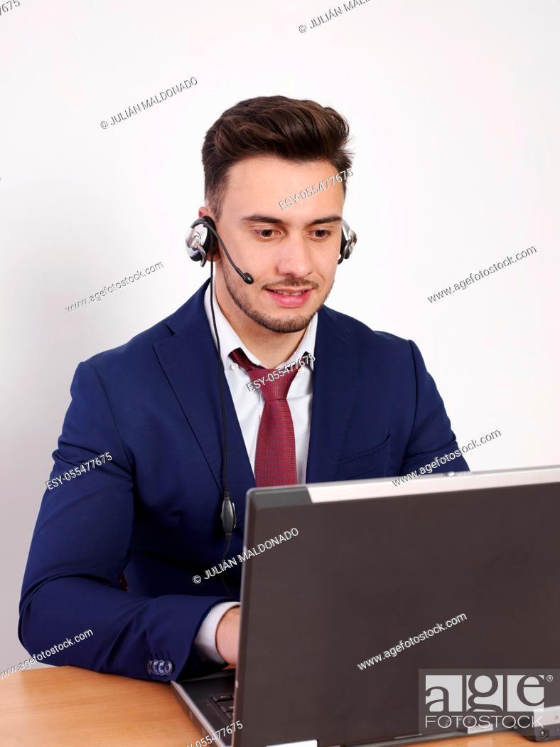 Stock Photo: Operator with positive aptitude answering customer calls.