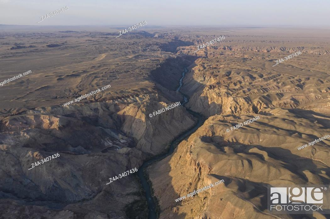 Stock Photo: Aerial view of the Charyn Canyon and Charyn River in Kazakhstan, Central Asia, at sunset.