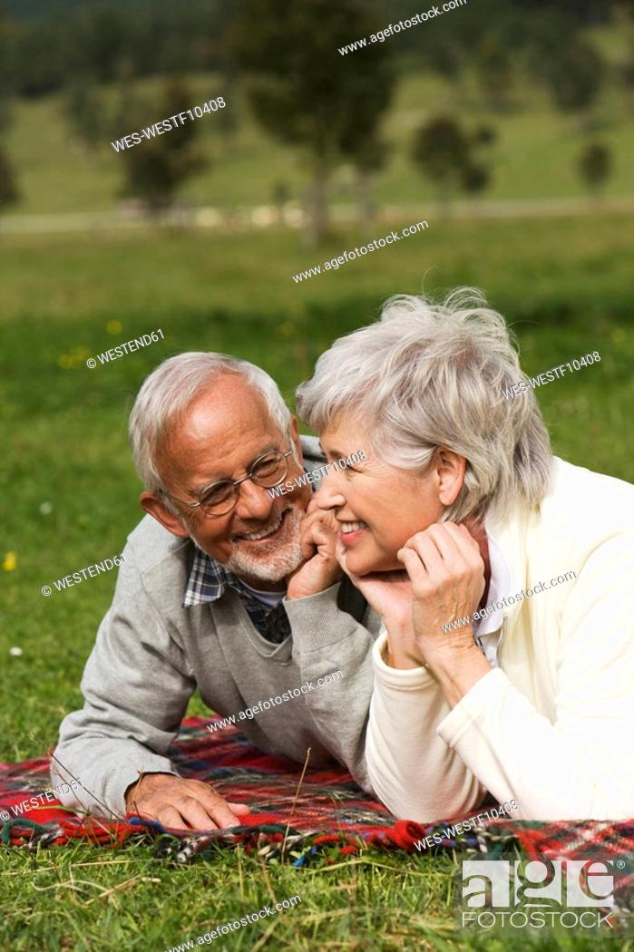 Stock Photo: Austria, Karwendel, Senior couple relaxing in meadow.