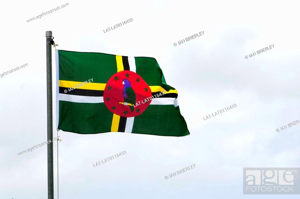 The National Flag Of Dominica Has A Green Background Black Yellow