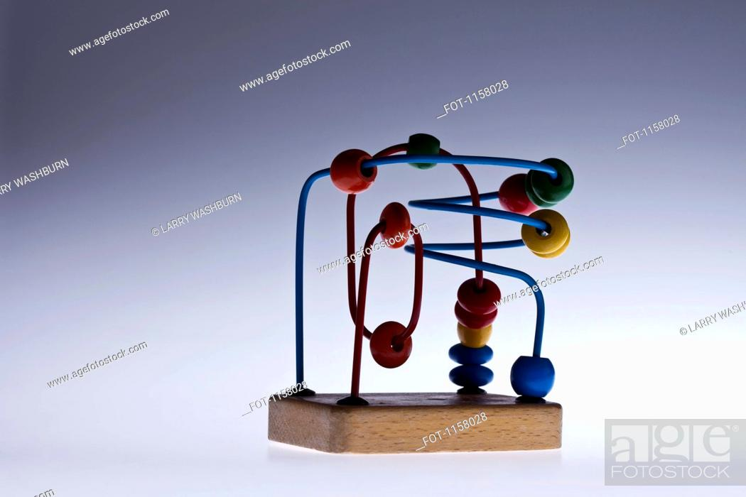 Stock Photo: A wooden bead maze children's educational toy.