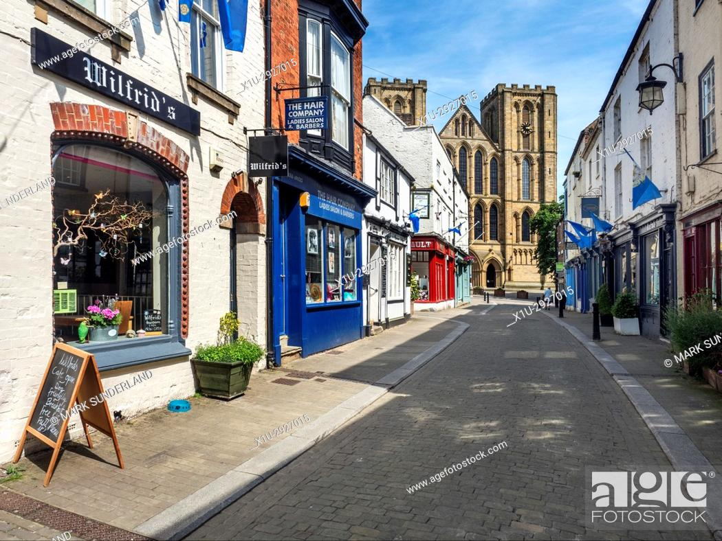Stock Photo: Ripon Cathedral from Kirkgate in Ripon North Yorkshire England.