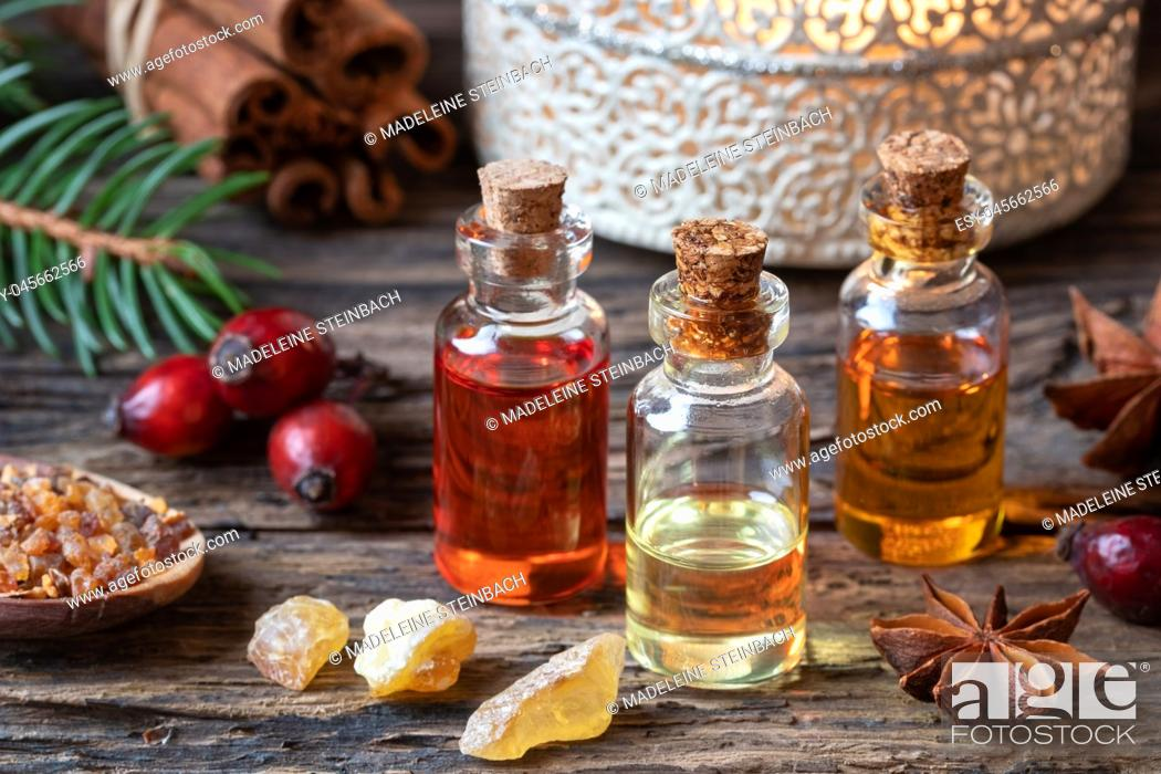 Stock Photo: Christmas collection of essential oils with frankincense, myrrh and rose hips.