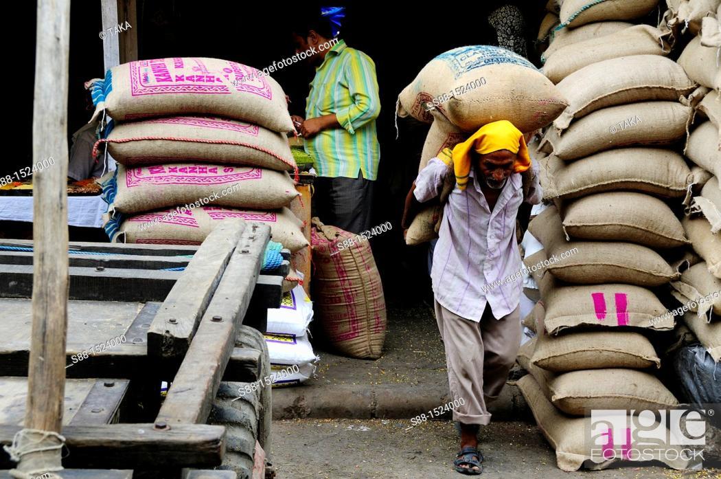 Stock Photo: Loading sacks of grain at Chandni Chowk, Old Delhi.