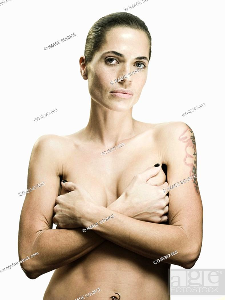 Stock Photo: Woman covering her breasts.