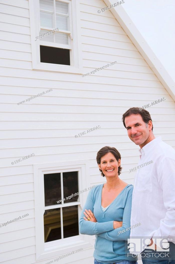 Stock Photo: Couple standing together in front of a house.