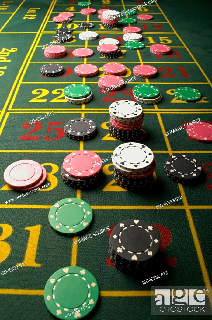 Stock Photo: Gambling chips on a roulette table.