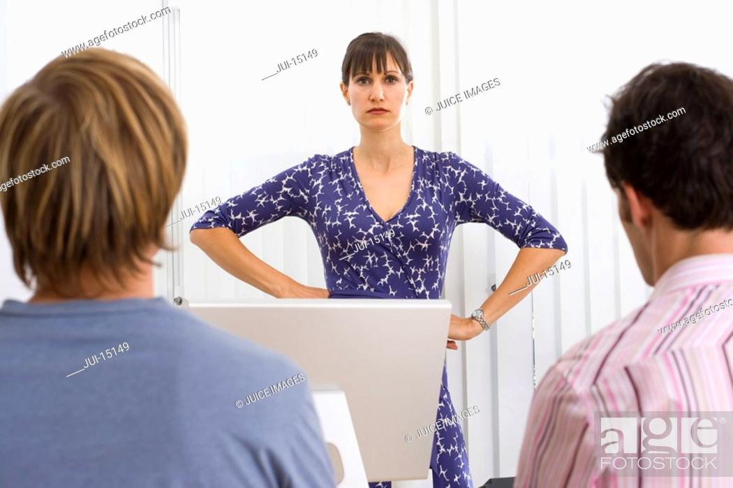 Stock Photo: Woman with hands on hips.