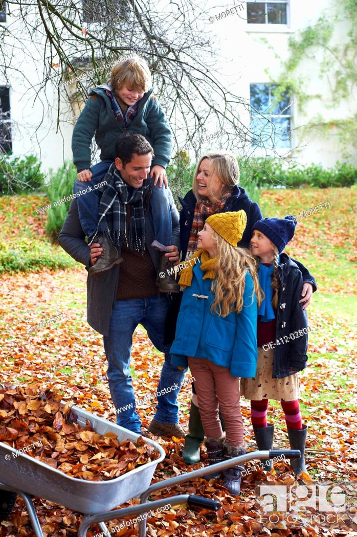 Stock Photo: Family standing together outdoors.