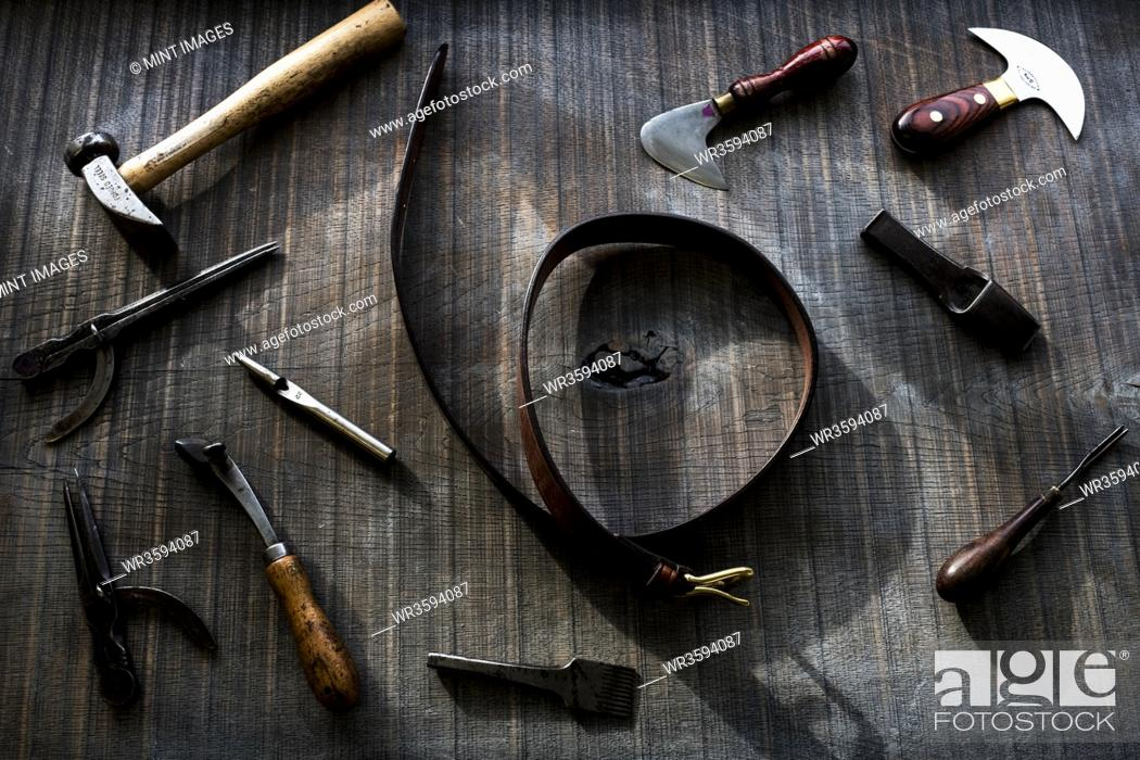 Stock Photo: High angle close up of selection of saddle making hand tools.