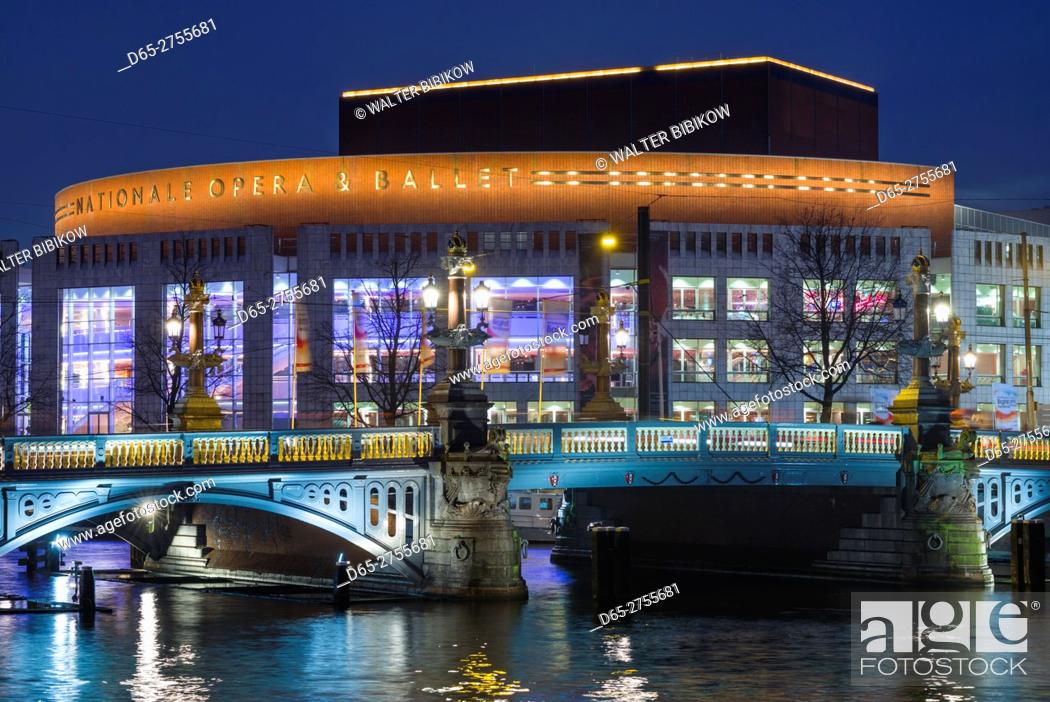 Stock Photo: Netherlands, Amsterdam, Amsterdam Music Theater on the Amstel River, dusk.